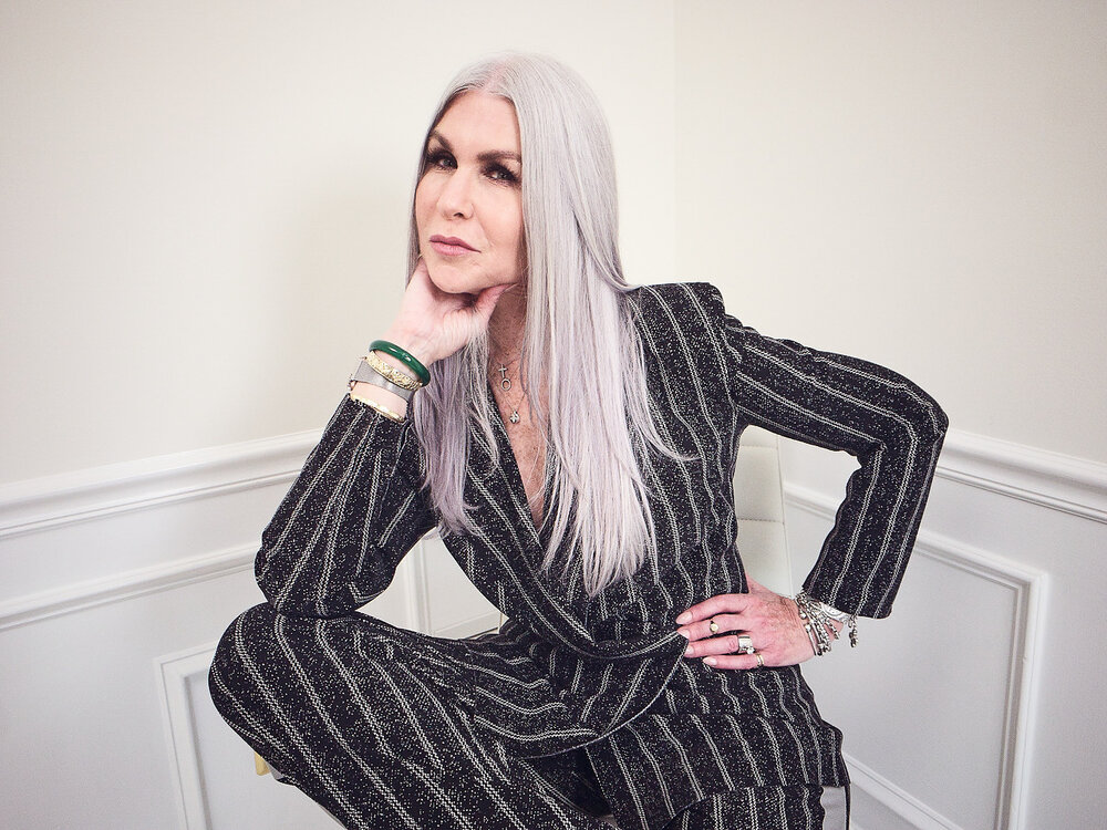 lisa in a pinstripe suit by norma komali