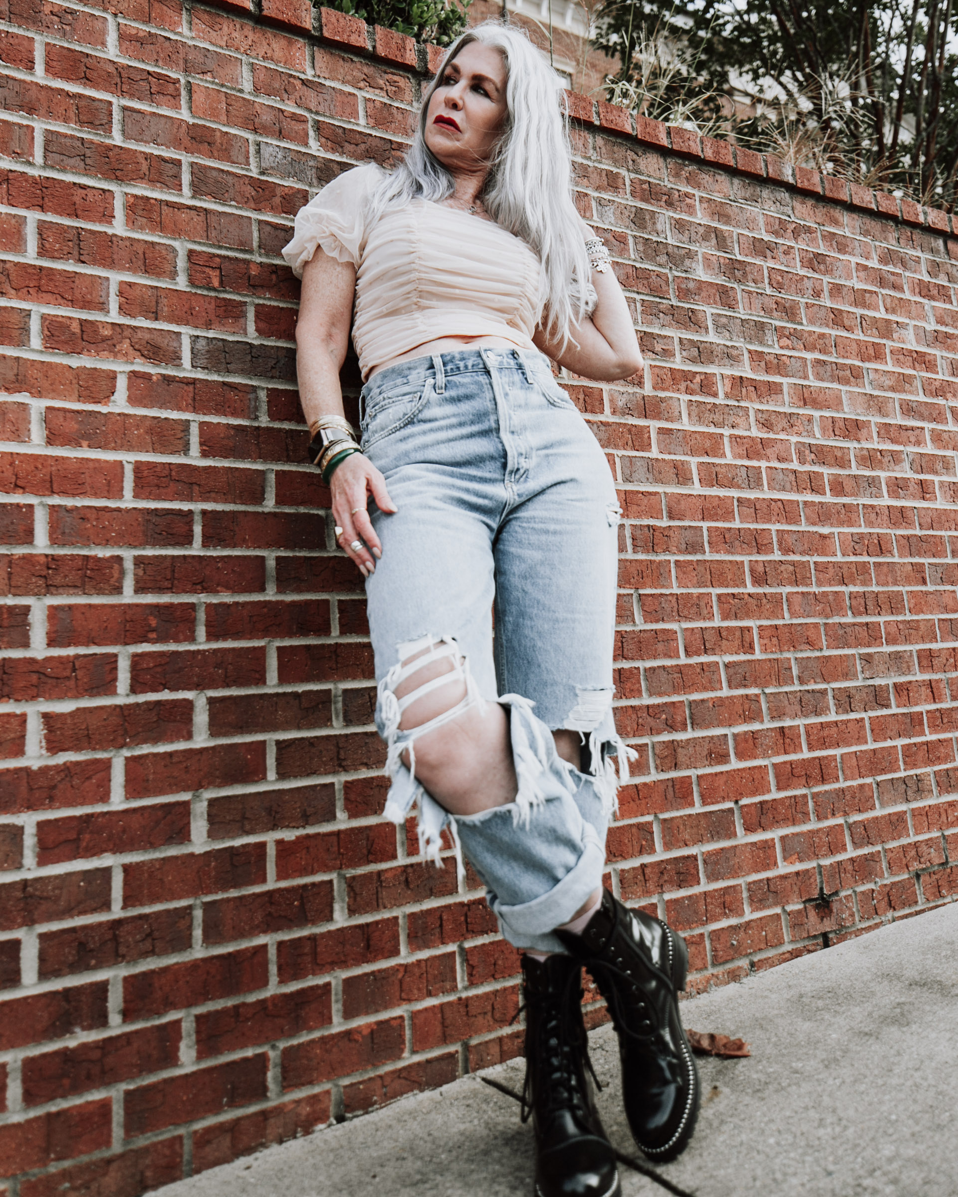 tulle top from h&m, ripped jeans from agolde, black combat boots from nordstrom