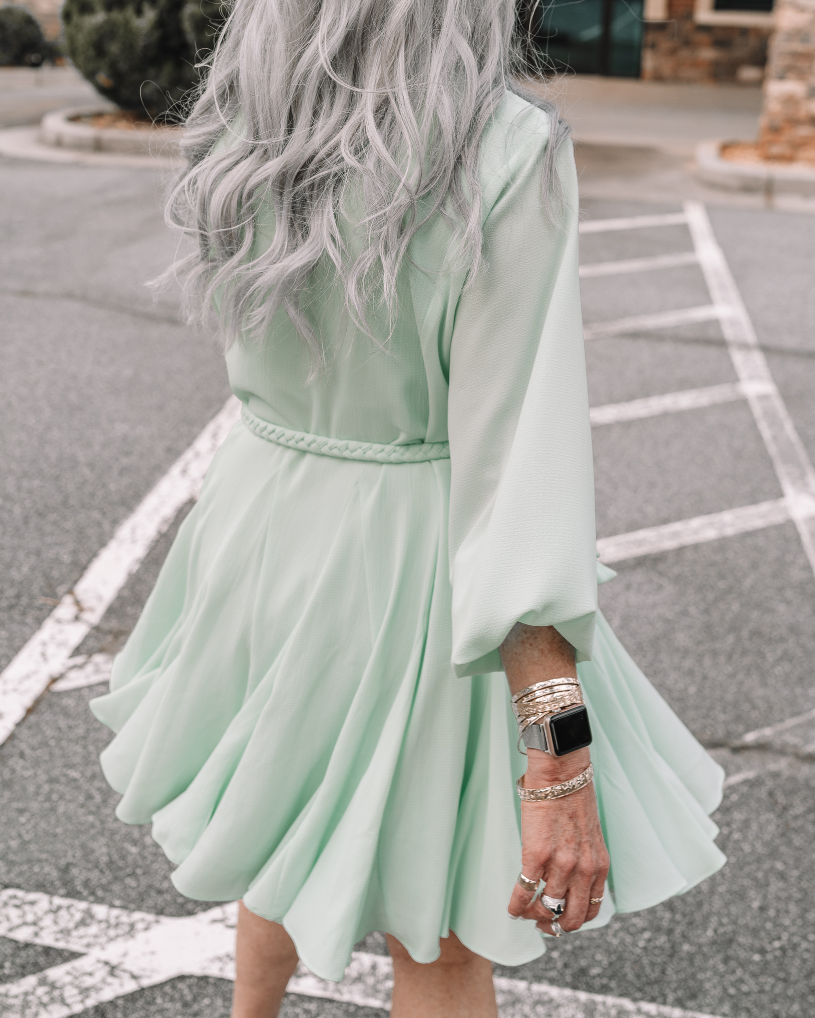 lisa in a mint green above the knee formal wedding guest dress and silver pumps